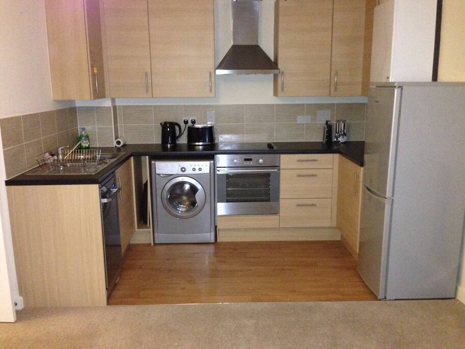 Modern kitchen with fridge/freezer, washer/dryer, stove, oven, microwave and dishwasher