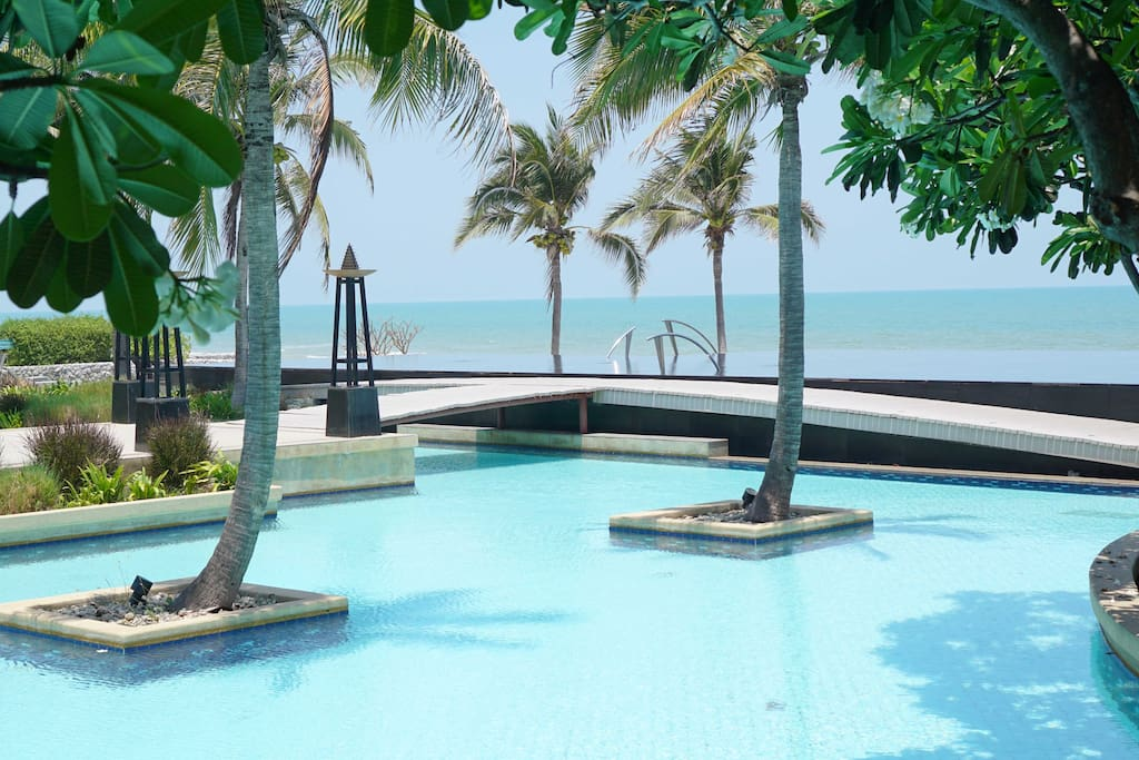 Infinity pool infront of beach front villa