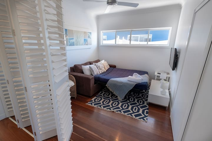 Upstairs Double Sofa Bed Bi Fold Plantation Shutters enclose area for privacy