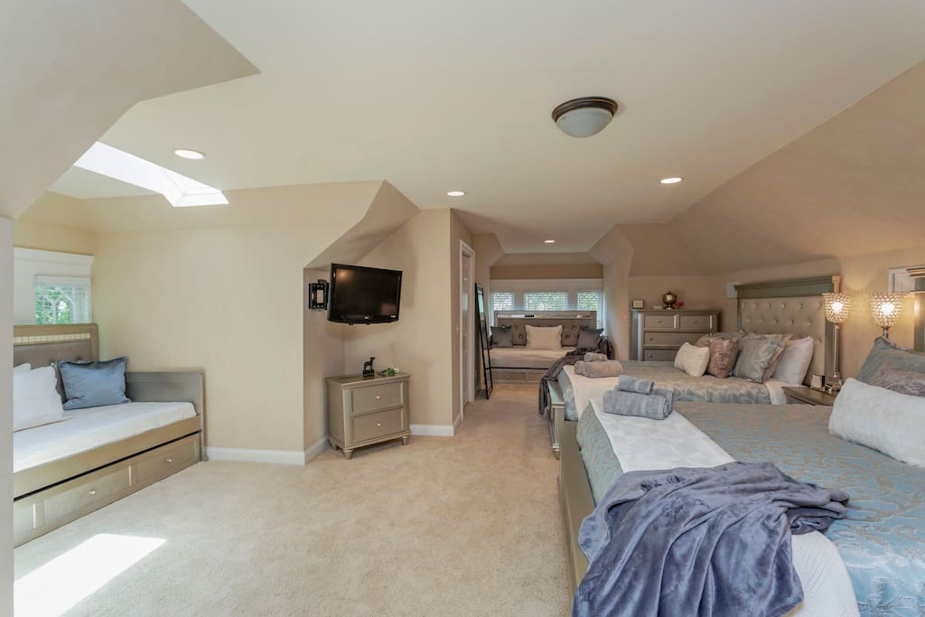 The spacious upstairs features 4 beds for versatile sleeping options: 1 king, 1 queen, 2 twins.