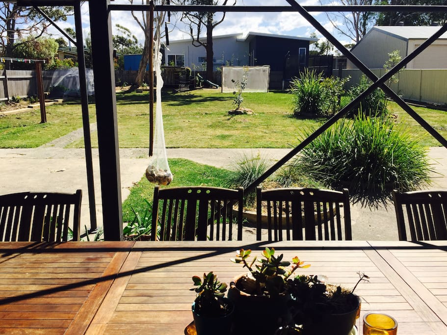 10 seater outdoor table overlooking the expansive grassy back garden.