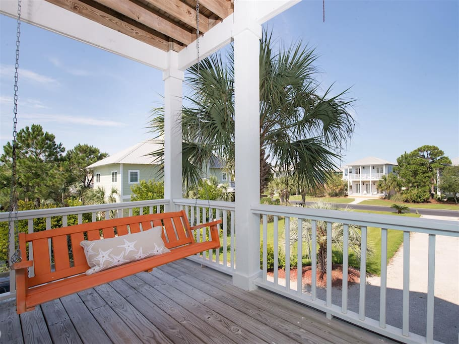 Gaze across your beachside community from the comfort of a porch swing.