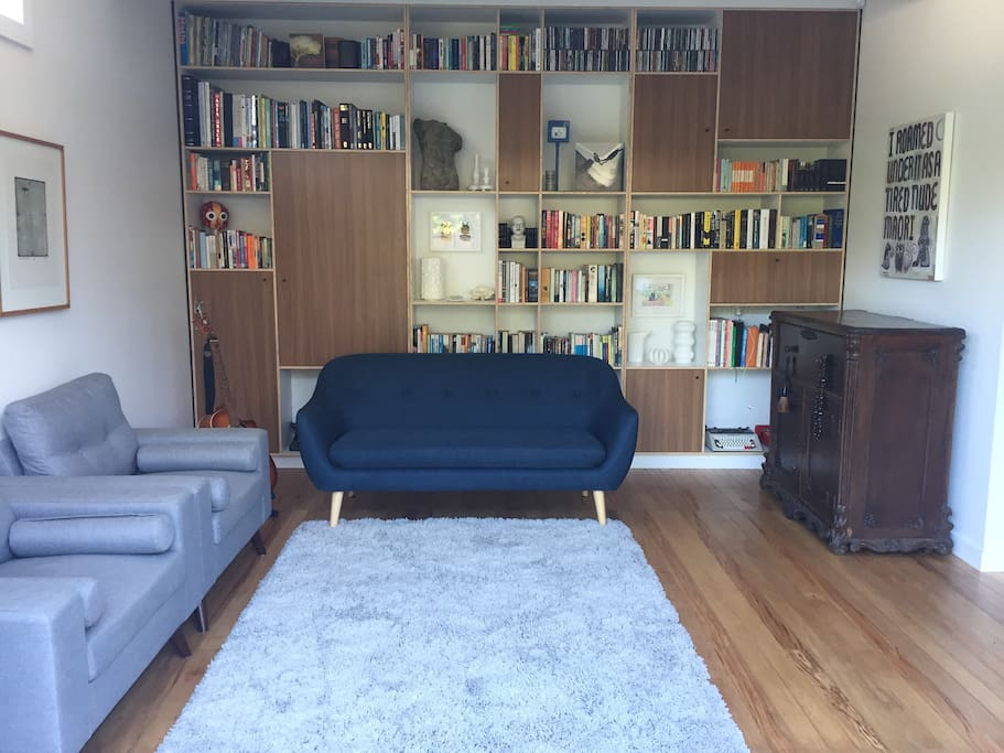 Reading room. Enjoy our book and game collection. A wall of glass doors opens back exposing you to the deck and garden.