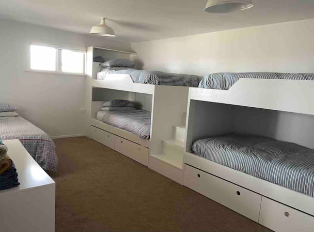 The four bunk beds are king single beds. The stairs between the bunks allow for easy access to top bunks. There is also a single bed.
