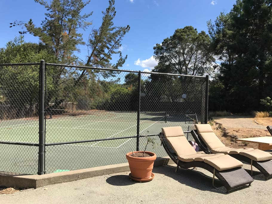 Tennis Court and Lounge Chairs in very large yard