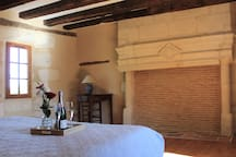 Larger bedroom on 1st floor has a stone carved fireplace