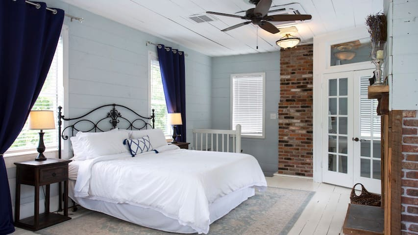 Shiplap before shiplap was cool! The house is loaded with 1800s detail like all wood walls, exposed brick, and hardwood floors.