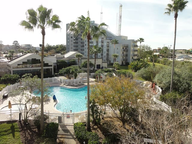 Apartment has view of community pool.
