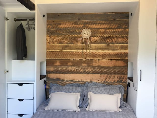 Queen Murphy bed and ample storage. Ground level, no stairs for easy access.