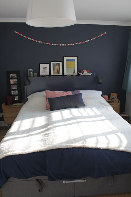 Bedroom containing king size bed, wardrobe and drawers