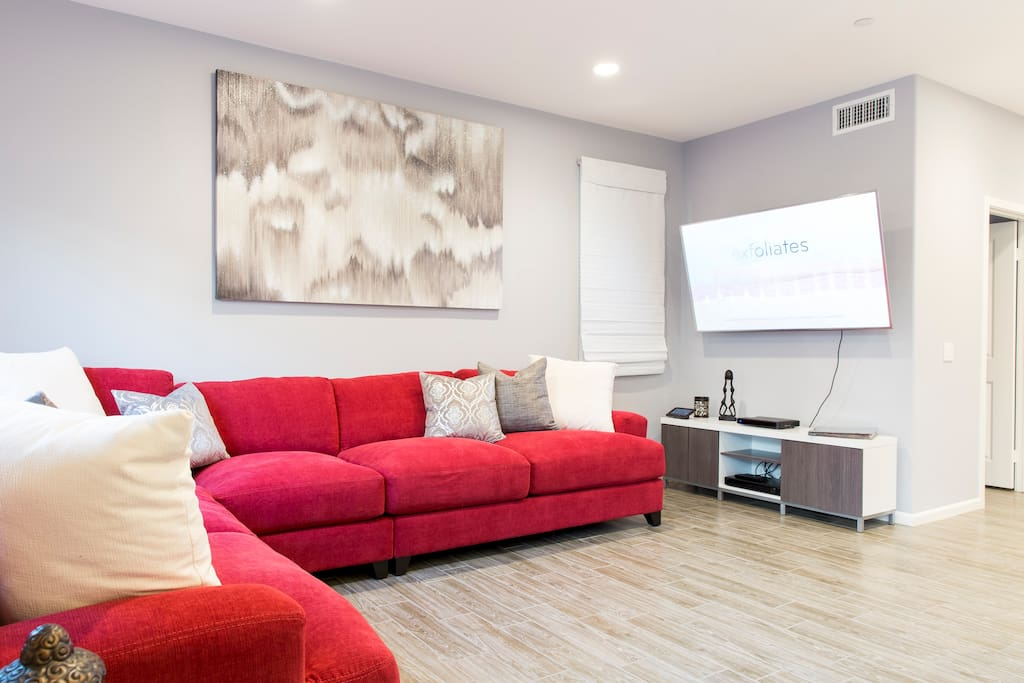 Living room, huge cozy couch and tv, you have full access