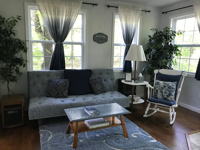 Beautiful blue ombre embroidered linen curtains may be pulled closed for maximum coziness and privacy, while still allowing diffused sunlight to enter.