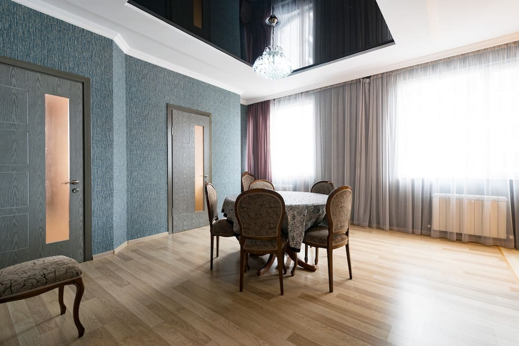 Dining room with two bedroom doors