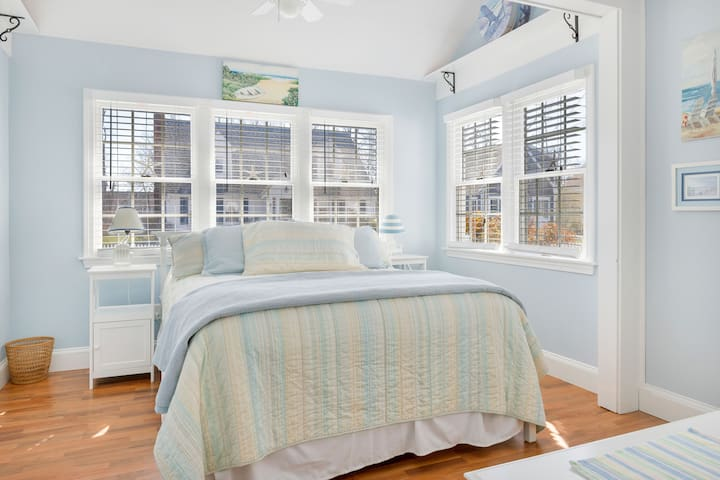 Sky blue Queen bedroom with lots of natural light!