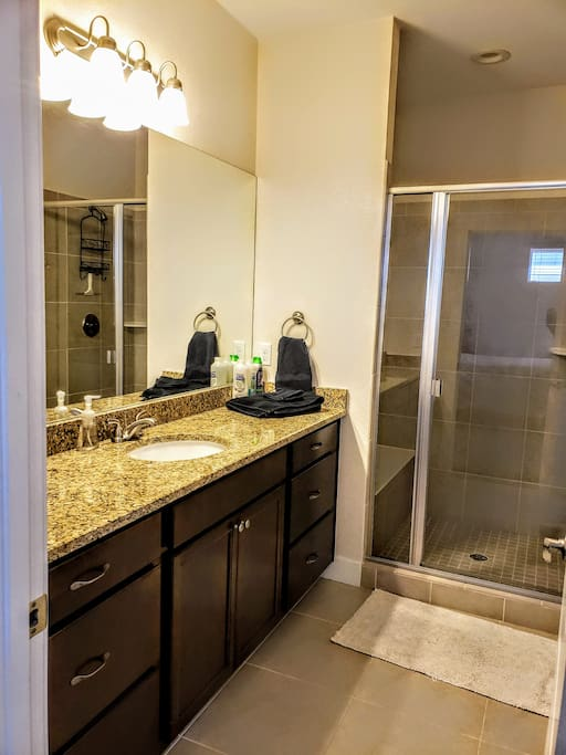 The bathroom is equipped with high end finishes. There is plenty of room in the closet to hang your clothes.