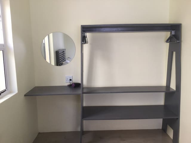 Clothing rack and makeup area with hair dryer