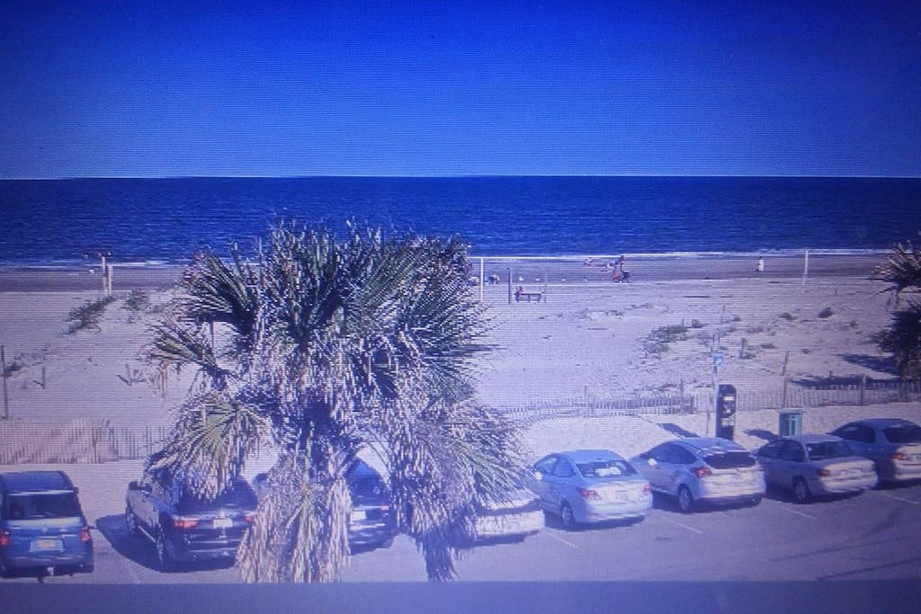 Beach in front of front of property .  Condo is on this side of parking lot .