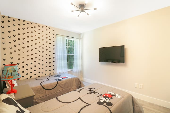 Mickey Mouse room features 2 single beds plush mattress, high threat count sheets and  43' Roku TV. USB outlet.
