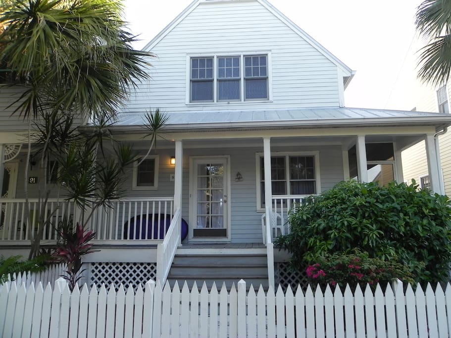 Beautiful townhouse in a gated community with a spacious wrapped around screened-in porch.