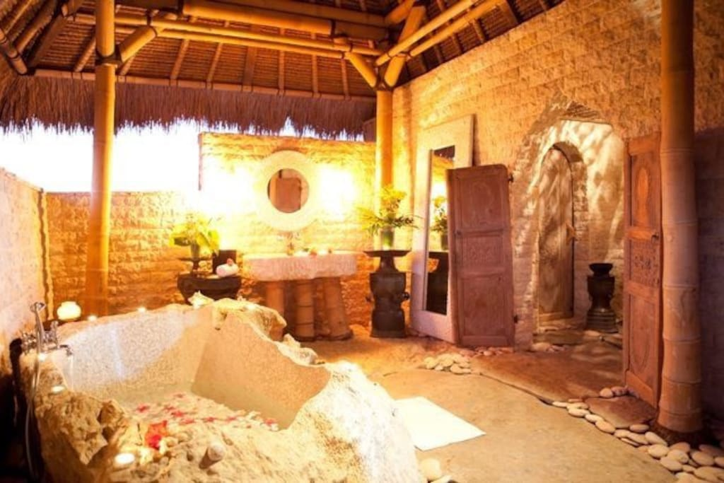 All suites have unique master bathrooms created in Bali's all-natural materials