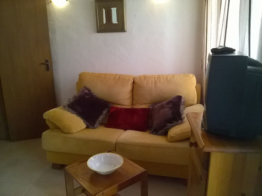Living area with a two seat sofa...