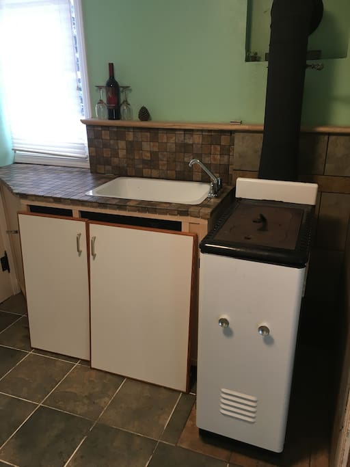 Wood stove and sink.