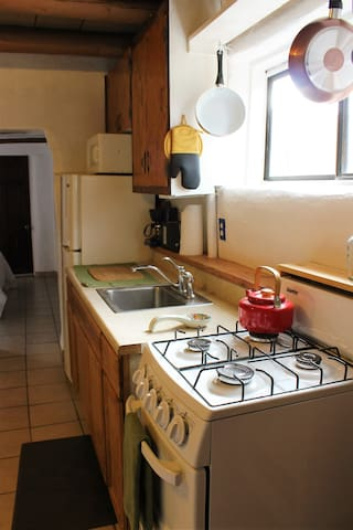 Clean and open kitchen to prepare meals