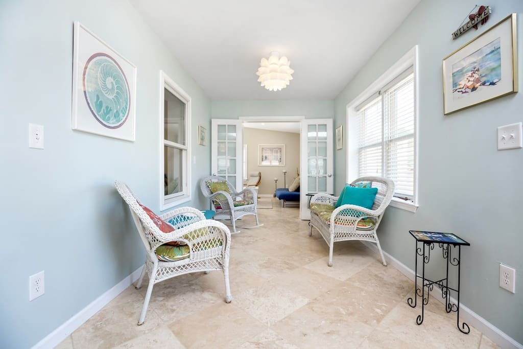 Unique Sunroom with gorgeous Custom Tile and Wicker Furniture welcomes you.