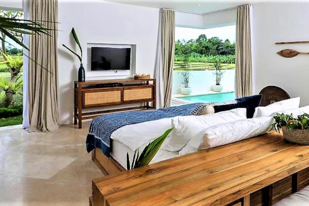 Master Suite #1 with direct Pool Access (King Size bed can convert to Twin Single option if needed).  Luxurious bed linens, fluffy duvets & plush pillows make sleeping a dream