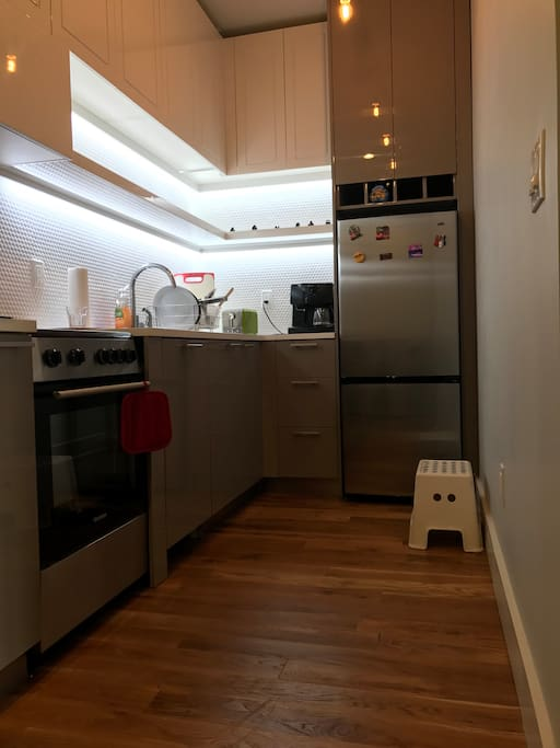 Clean kitchen with cooking utensils for food preparation