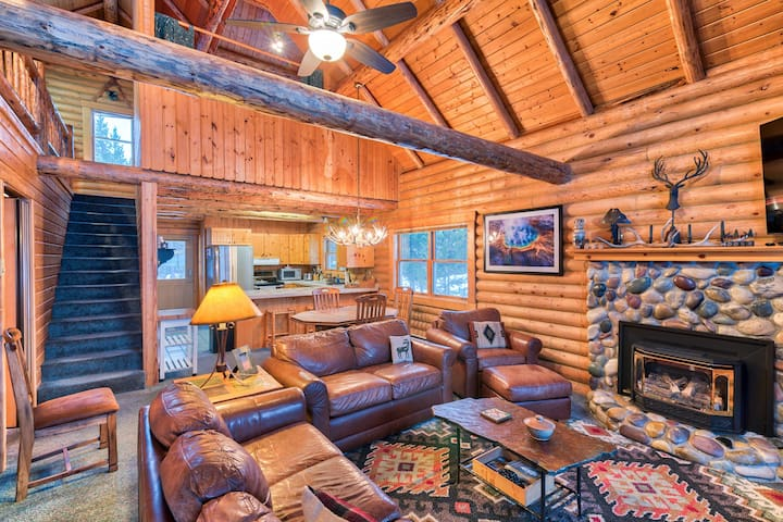 Relax in the inviting living room while you enjoy the warmth of the river rock fireplace.