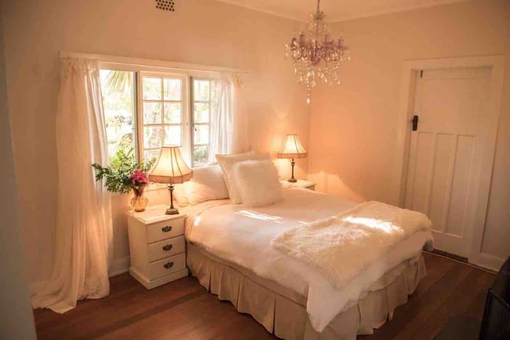 Bedroom with en-suite and out door shower. An authentic open fireplace. Private entrance to sunroom and front verandah
