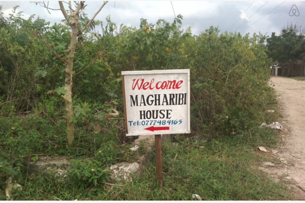 Welcome to Magharibi House! This is our sign that can be seen from the road.