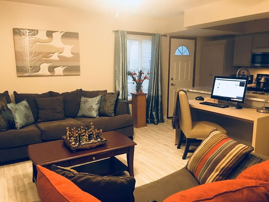 Living Room with work desk and free WiFi connection