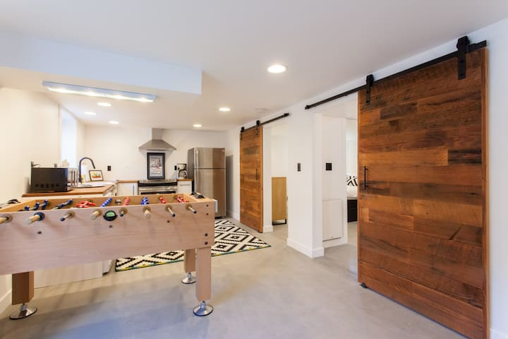 Open living room and kitchen, with beautiful reclaimed wood barn doors...
