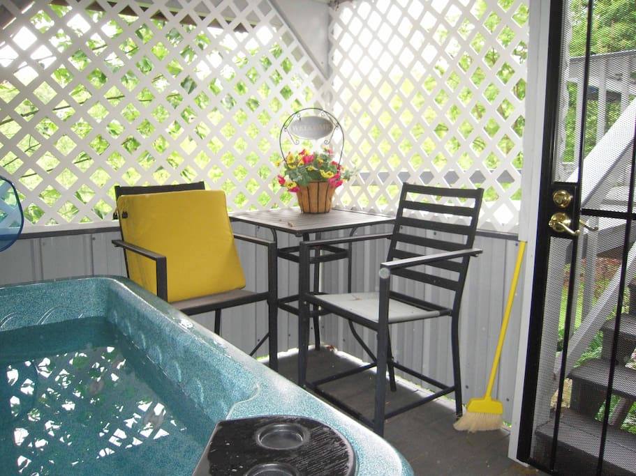 HOT TUB on the lower deck is accessible by an outside staircase. Now lattice screened with safety doors to exclude the bears