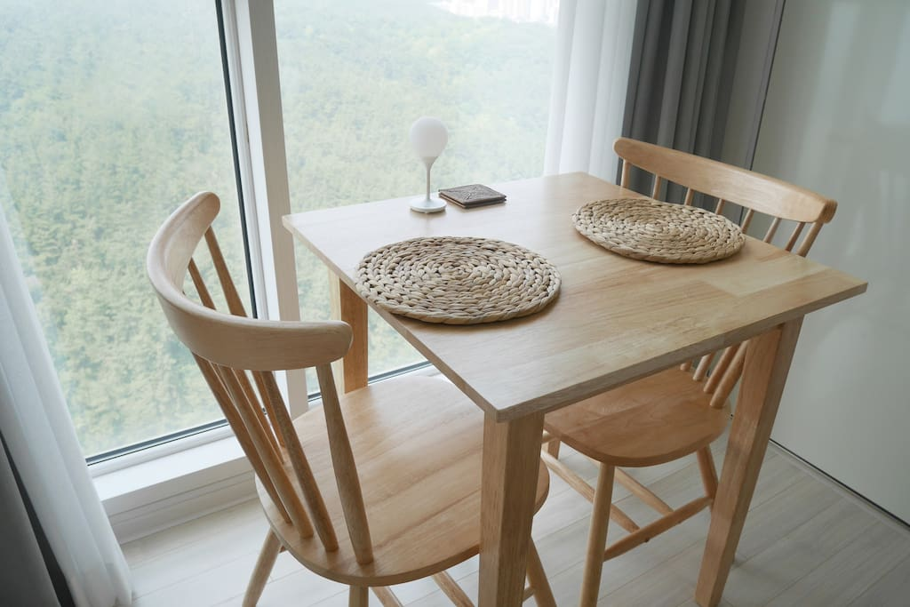 Comfortable dining table and workspace with gorgeous mountain view.