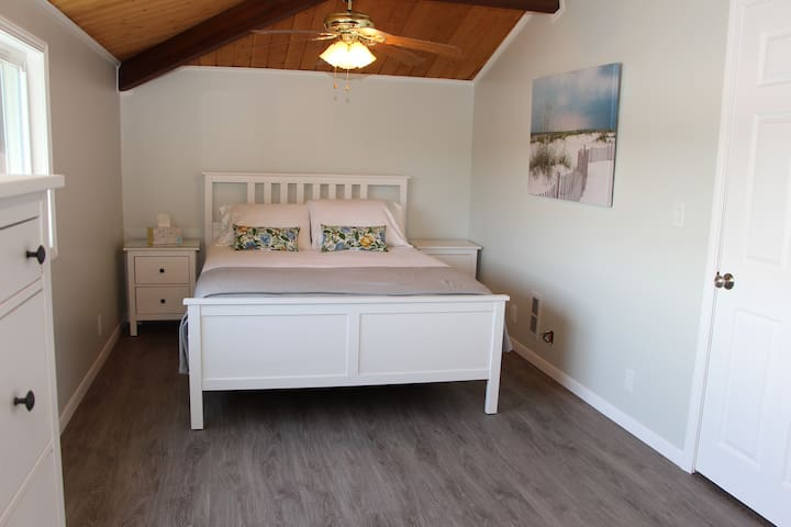 2nd floor master bedroom with queen bed and matching night stands