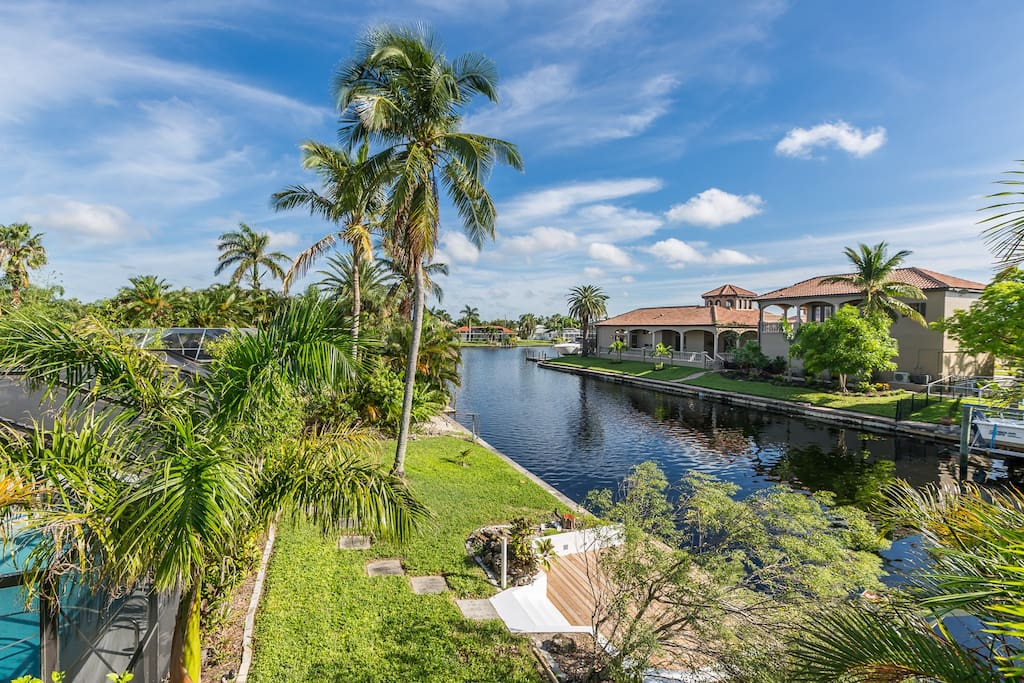 With an idyllic setting on the canal, access to a boat dock, and a private pool, this home has it all.