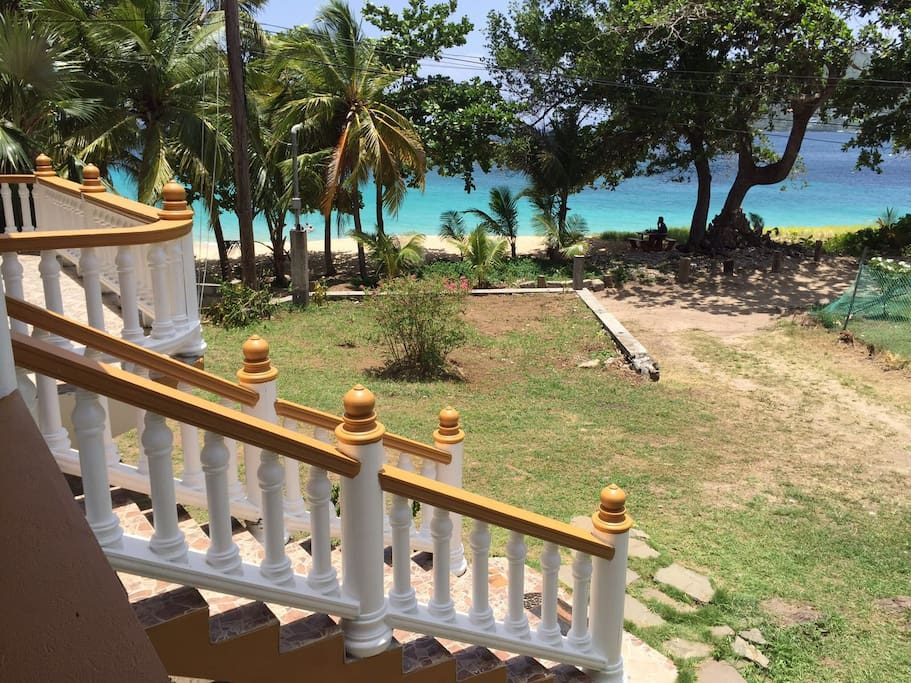 View from the end of veranda: a walk down driveway directly onto beach