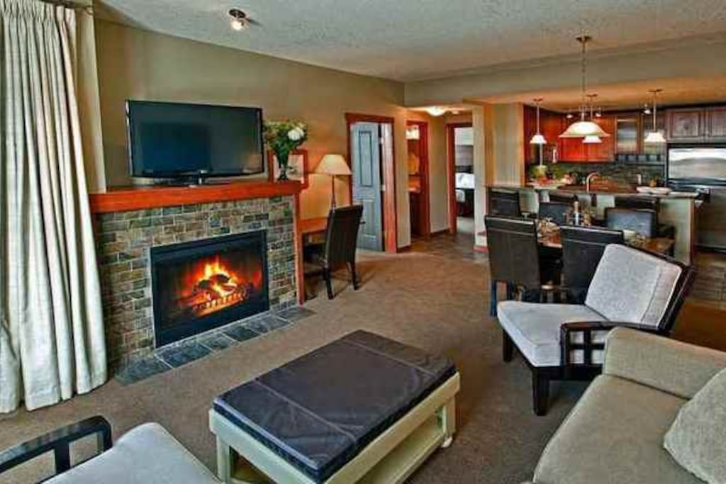 This comfortable condo features a cozy fireplace and modern kitchen