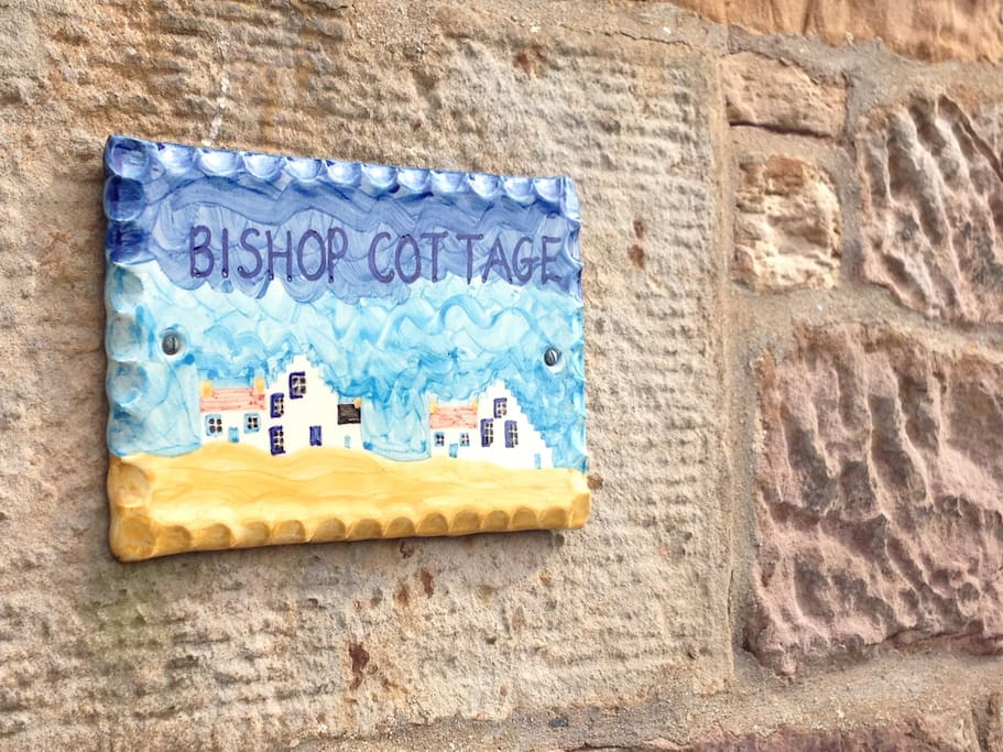 Our handpainted sign from Crail Pottery