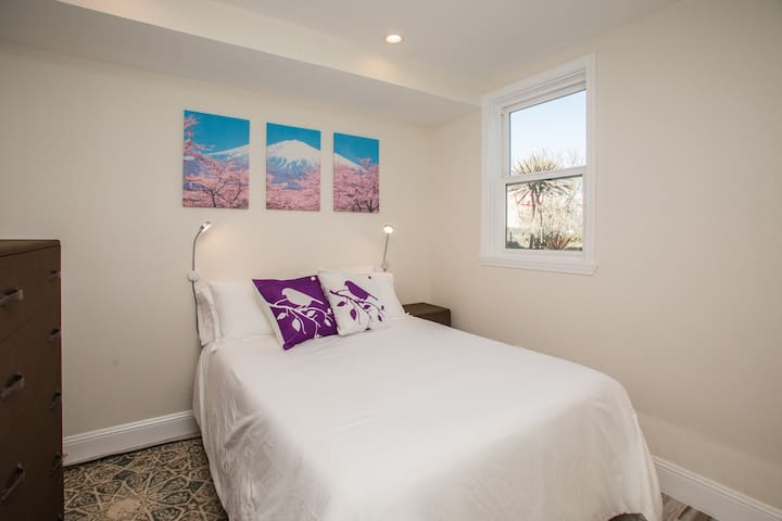 Second bedroom also with all cotton sheets and TV with Amazon Fire Stick. Big art and new paint make your room feel fresh and spacious.