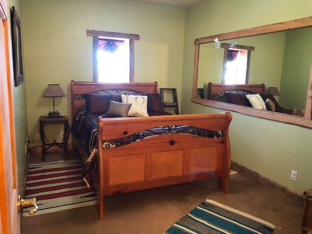Cozy queen bedroom.