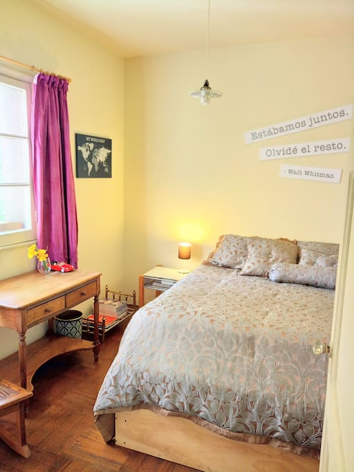 Room: it is a nice bright room that has a queen bed, a big window, desk, night table and closet