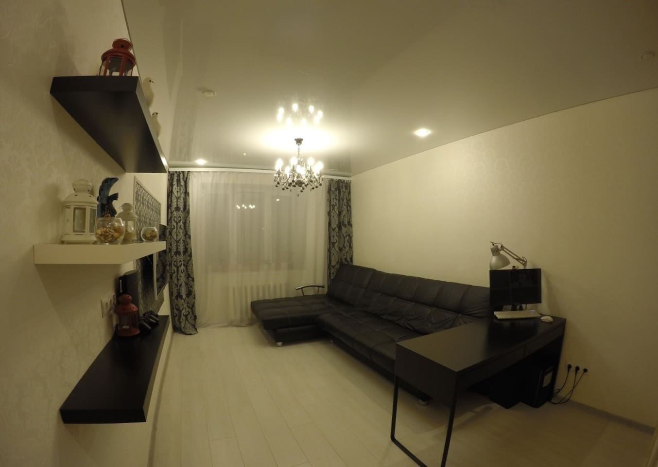 spacious living room with workplace