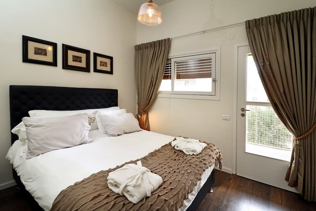 One of the two bedrooms in the suite, a queen size bed with luxurious sheets and linen. This bedroom also has a dedicated exit to the balcony.