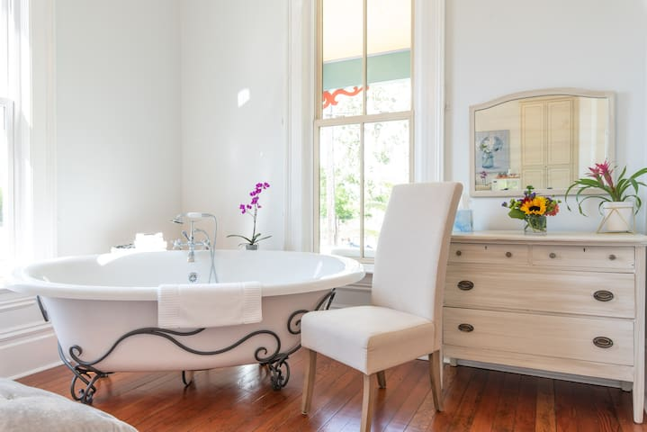 Large 2 person soaking tub and a dimmable Chandelier above. All perfect for a romantic relaxing evening!