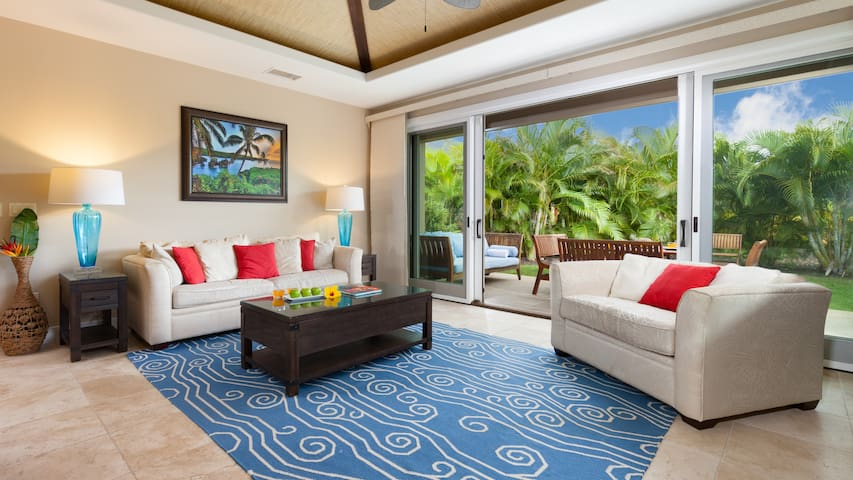 Large Living Room with queen + twin sleepers opens to lush green outdoor living