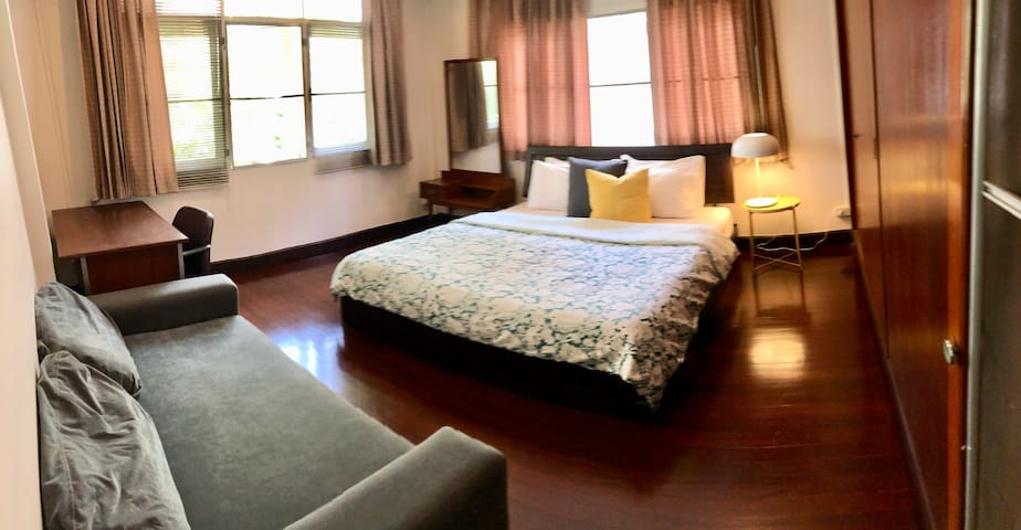 Large bright King Bedroom in charming 60s House